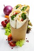 pic of sandwich wrap  - tortilla wraps with chicken and fresh vegetables isolated on white - JPG