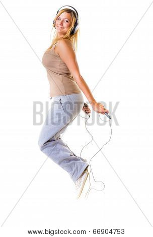 Sport Fitness Girl With Headphoes Doing Exercise With Skip Jump Rope
