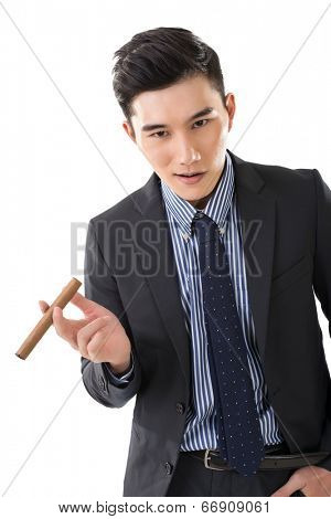 Bad Asian businessman hold a cigar and sized you up viciously, closeup portrait.