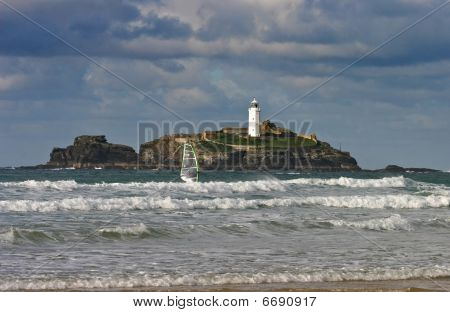 A Windsurfer Sails Past Godrevy Lighthouse West Cornwall