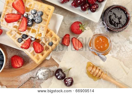Sweet waffles with honey and berries