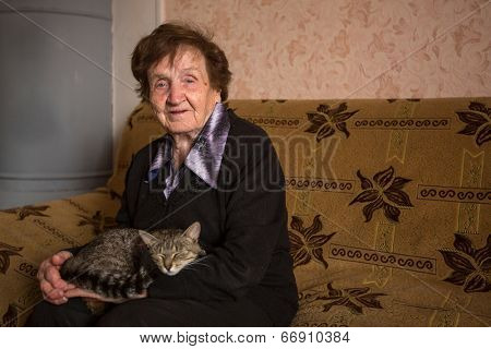 An elderly woman with cat.
