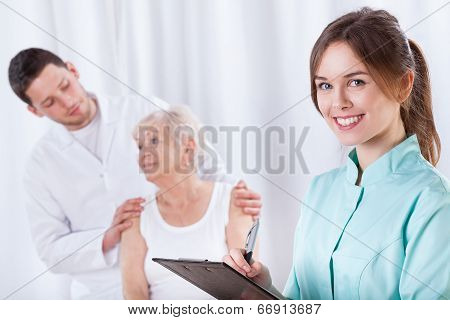 Elderly Woman With Doctors During Rehabilitation
