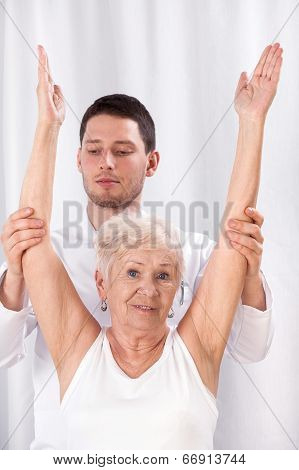 Physiotherapist And Elderly Woman During Rehabilitation