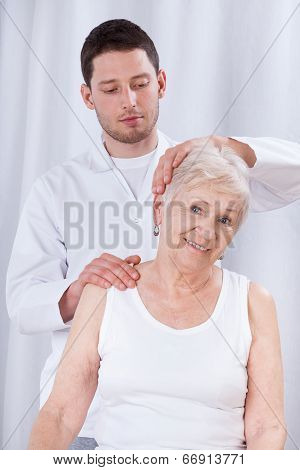 Physiotherapist Rehabilitating Woman