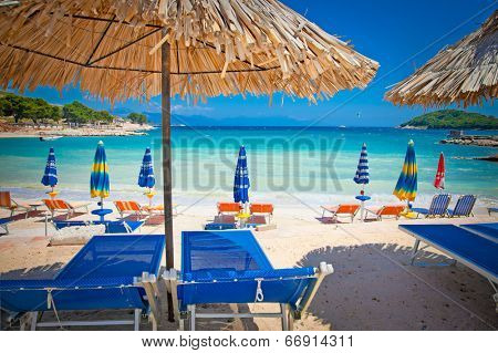 Sunshade umbrellas and deckchairs on the beautiful Ksamil beach, Albania.