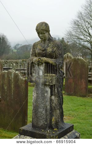 Solemn Tombstone Lady with Cross
