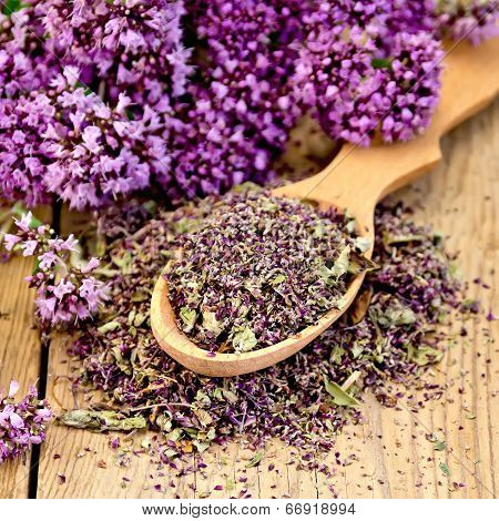 Herbal Tea Of Dry Oregano In Spoon On Board