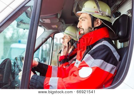Emergency doctor and nurse driving ambulance