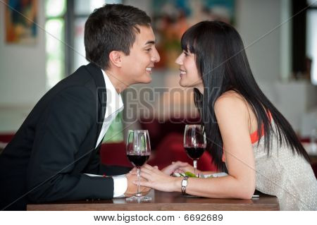 Couple Kiss Over Meal