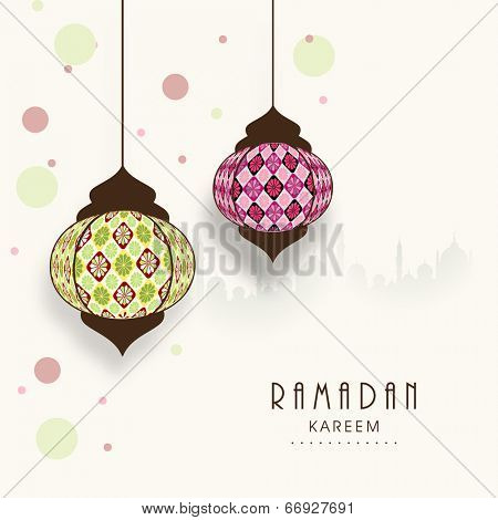 Stylish hanging arabic lanterns on mosque silhouetted colorful abstract background for holy month of Muslim community Ramadan Kareem.