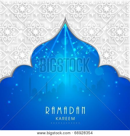 View of mosque in shiny blue night background for holy month of muslim community Ramadan Kareem.