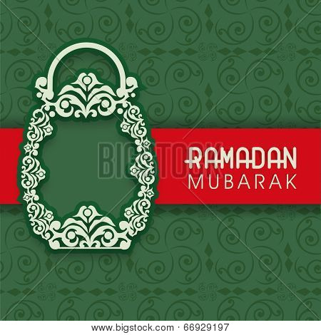 Beautiful floral design decorated arabic lantern on seamless floral pattern green background for celebration of holy month Ramadan Mubarak.