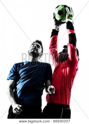 two  soccer player goalkeeper men catching heading ball competition in silhouette isolated white background