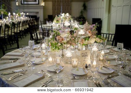 elegant table setting for wedding reception with bouquets