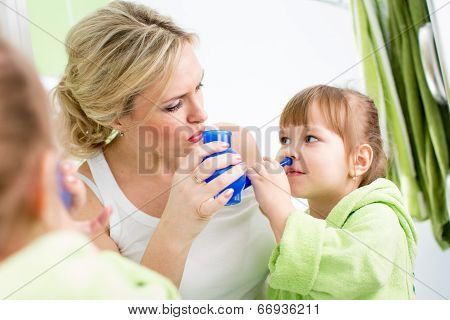 Mother And Kid With Neti Pot Ready For Nasal Irrigation Or Douche