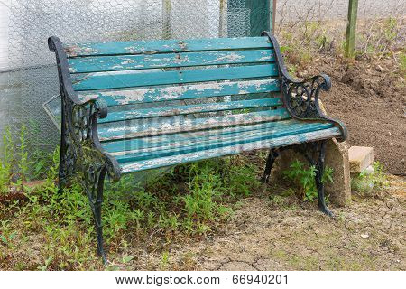 Old Bench Overgrown With Weeds
