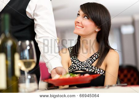 Waiter serving food in a luxury restaurant