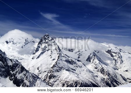Snowy Mountains And Blue Sky With Clouds