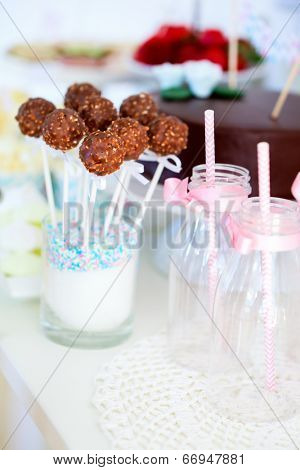 Chocolate cake pops on a dessert table at party or wedding celebration