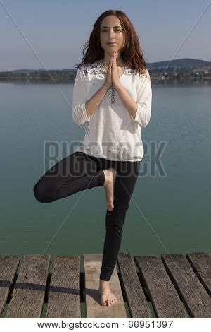 Yogi Woman Doing Tree Pose Outdoors In Nature
