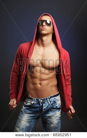 Handsome Young Man With The Unbuttoned Hooded Shirt