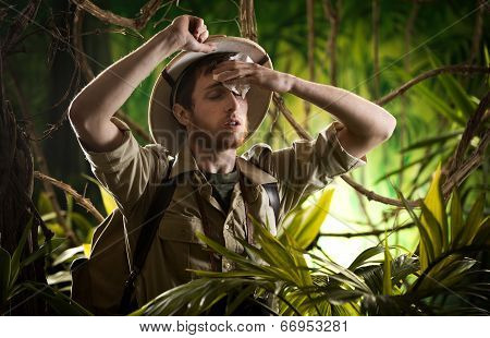 Exhausted Young Explorer In The Jungle