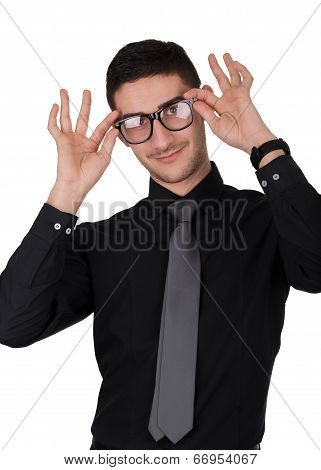 Young Man Putting On Glasses