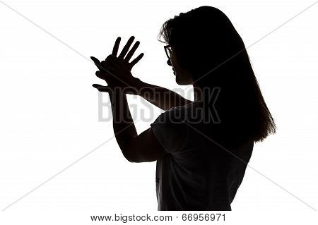 Silhouette of girl making shadows play