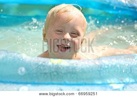 Happy Young Child Swimming In Pool