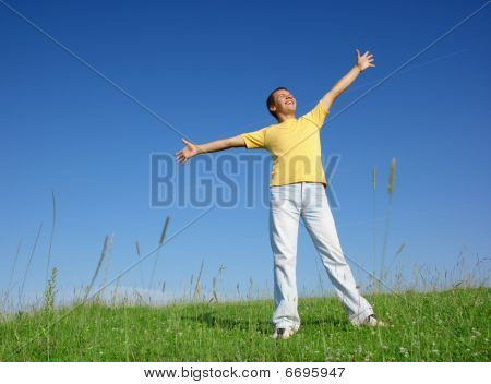 Happy Young Man On The Meadow
