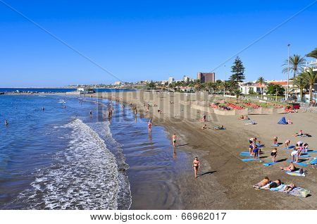 MASPALOMAS, SPAIN - OCTOBER 15: Playa del Ingles beach on October 15, 2013 in Maspalomas, Gran Canaria, Canary Islands, Spain. This is an important winter tourist destination for many europeans