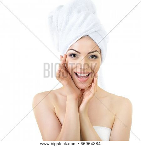 Fresh clean beautiful smiling woman wrapped in bath towels. Health, treatment, care and cosmetology concept
