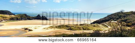 Panoramic view of Three Cliffs Bay on the Gower Peninsula in South Wales, UK