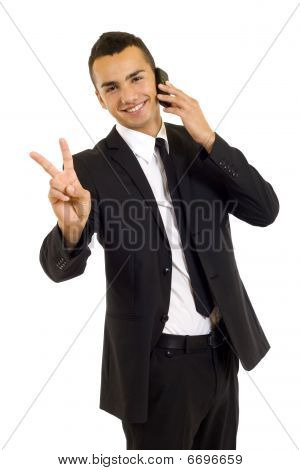 Businessman On The Phone Making His Victory Sign