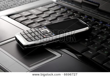 Smartphone On A Laptop