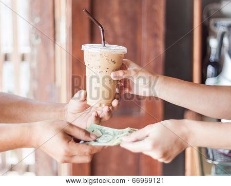 Giving Money For Freshly Brewed Coffee