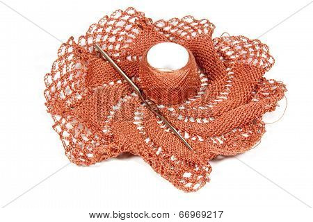 Salmon Colored Crocheted Doily With Crochet Hook