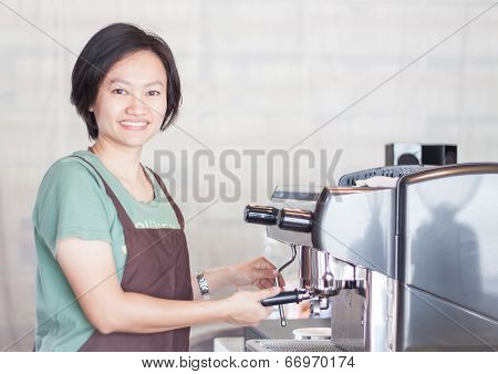 Asian Barista Smiling And Making Cup Of Coffee