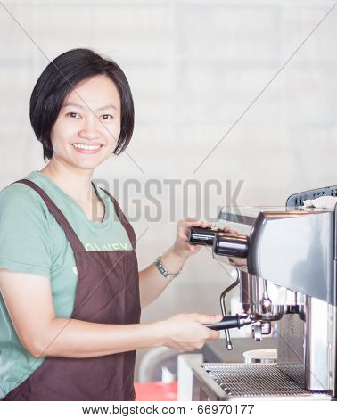 Woman Barista At Work In Coffee Shop