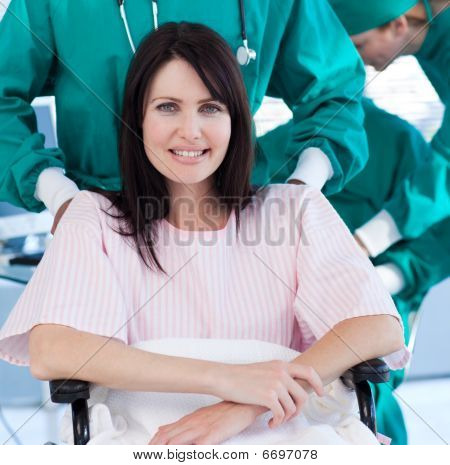 Portrait Of A Positive Patient Sitting On A Wheelchair