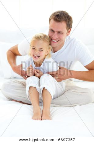 Attractive Father Playing With His Little Girl