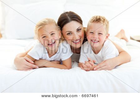 Laughing Children Playing With Their Mother