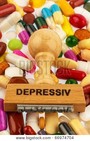 stamp on colorful tablets, symbol photo for depression, therapy and psychotropic drugs
