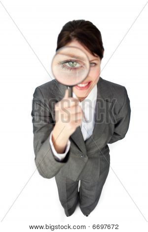 Young Businesswoman Looking Through Magnifying Glass