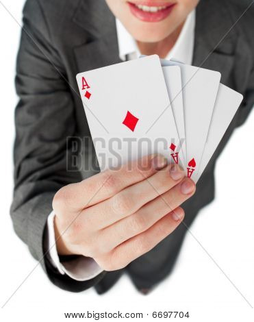 Close-up Of A Businesswoman Holding All The Aces