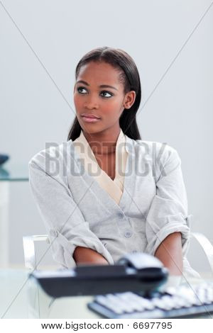 Portrait Of A Beautiful Ethnic Businesswoman At Her Desk