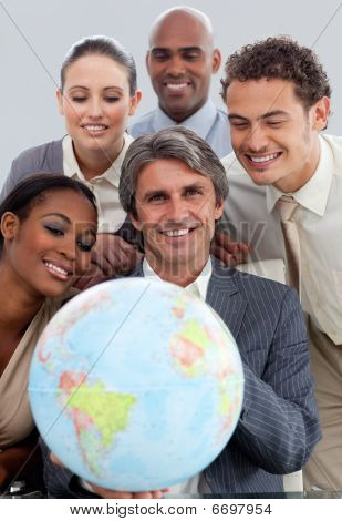 A Diverse Business Group Showing A Terrestrial Globe