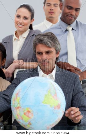 Multi-ethnic Business People Around A Terrestrial Globe
