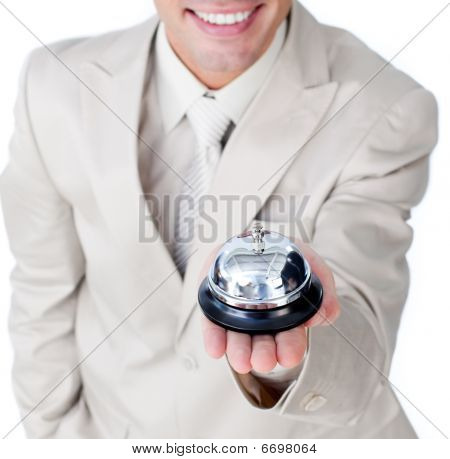 Close-up Of A Caucasian Businessman Holding A Service Bell